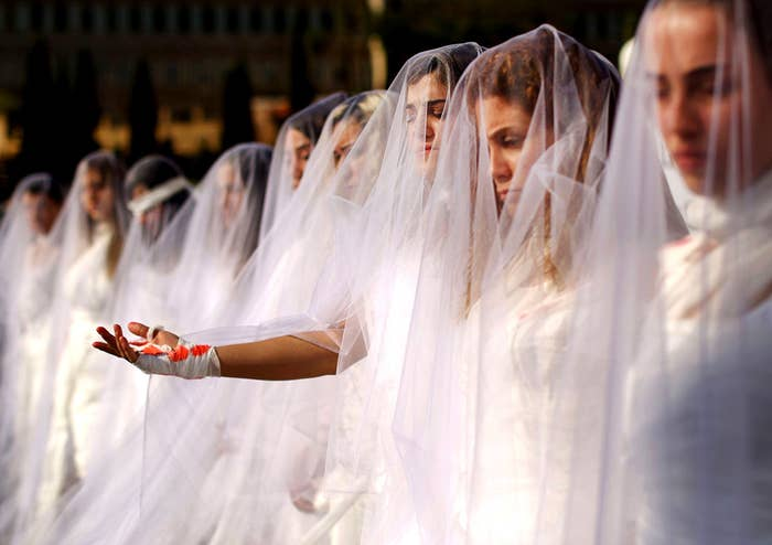 Activists dressed as brides and wearing bandages hold a protest in downtown Beirut against article 522 in the Lebanese penal code. The article shields rapists from prosecution on the condition that they marry their victim, a phenomenon that is still practiced in the country, especially among conservative families whose chief aim is to preserve the family's so-called honor.