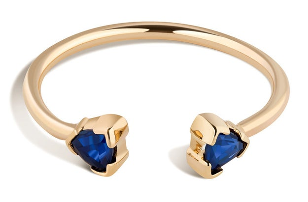 An open-ended sapphire ring that definitely stands for compromise.