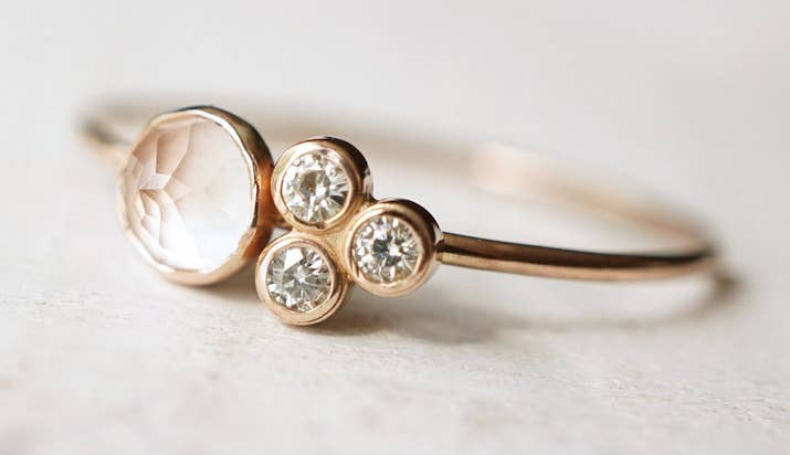 a rose quartz and moissanite ring that confirms that four is not a crowd - Non Diamond Wedding Rings