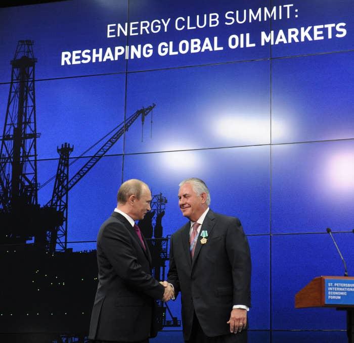 Russian President Vladimir Putin and Rex Tillerson at an awards ceremony.
