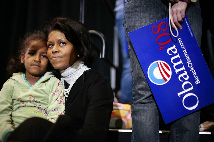 US Sen. Barack Obama's wife, Michelle, and daughter Sasha watch as the Democratic Party senator from Illinois speaks to the crowd during a rally at Iowa State University in Ames on Feb. 11, 2007. Obama formally announced his 2008 campaign for president during a rally the day before.