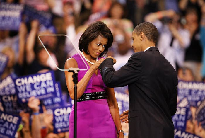 Michelle Obama fist-bumps her husband before an election night rally at the Xcel Energy Center on June 3, 2008, in St. Paul, Minnesota.