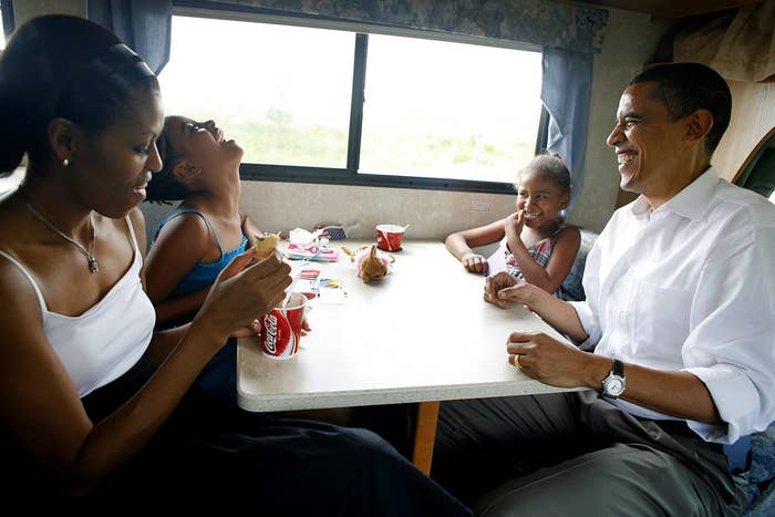 Democratic presidential hopeful US Senator Barack Obama, his wife Michelle, and two daughters Sasha and Malia play cards in their RV on July 4, 2007, during a campaign swing between Oskaloosa and Pella, both in Iowa.