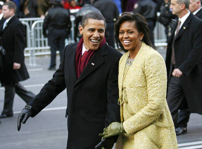 Michelle Obama walks down Pennsylvania Avenue with the newly sworn-in 44th president of the United States, Barack Obama, during the inaugural parade in Washington on Jan. 20, 2009. The first lady is wearing a custom-made ensemble by Cuban-born American designer Isabel Toledo.