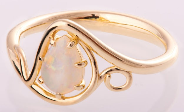 A gorgeous opal ring intertwined in ribbons of gold.