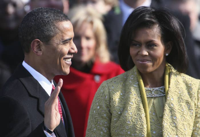 Barack Obama with his wife, Michelle, takes the oath of office in 2009.