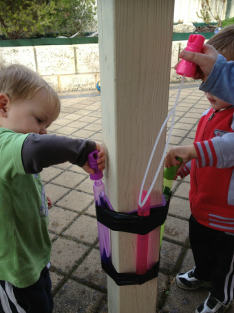 Tape your kid's bubble wand to a pole or wall for a spill-proof bubble station.