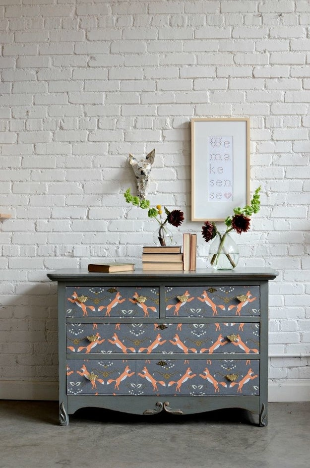And you can transform old furniture with nothing but Mod Podge and wallpaper.
