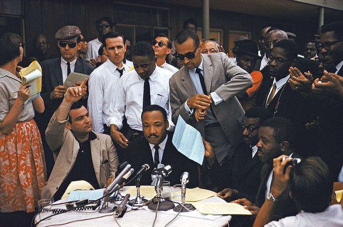 King surrounded by reporters during a public address in Birmingham, Alabama, in 1962.