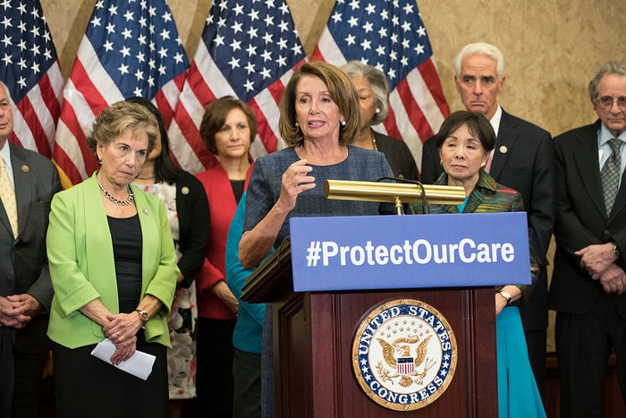 House Minority Leader Nancy Pelosi, flanked by House Democrats, speaks in support of the Affordable Care Act on January 12.