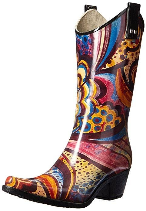 cowboy boot shape rain boot with a colorful abstract pattern on it