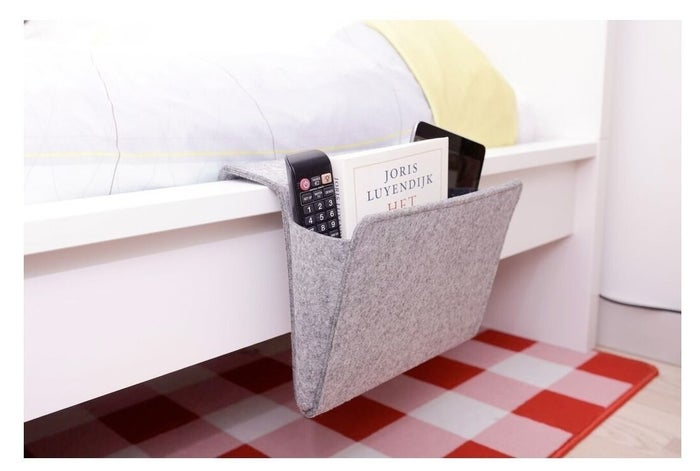 """Promising review: """"I bought this because my bedroom doesn't have space for two nightstands, so a caddy on one side is perfect. Looks great and works well."""" —Jessica YuPrice: $20"""