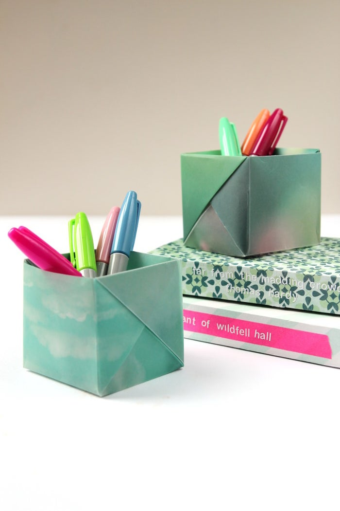 Learn how to make this origami pencil holder on Gathering Beauty.