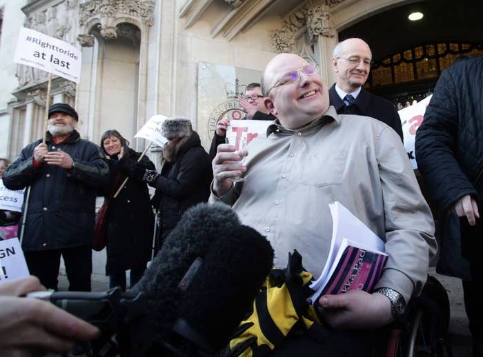 Doug Paulley celebrates outside court after today's judgment.