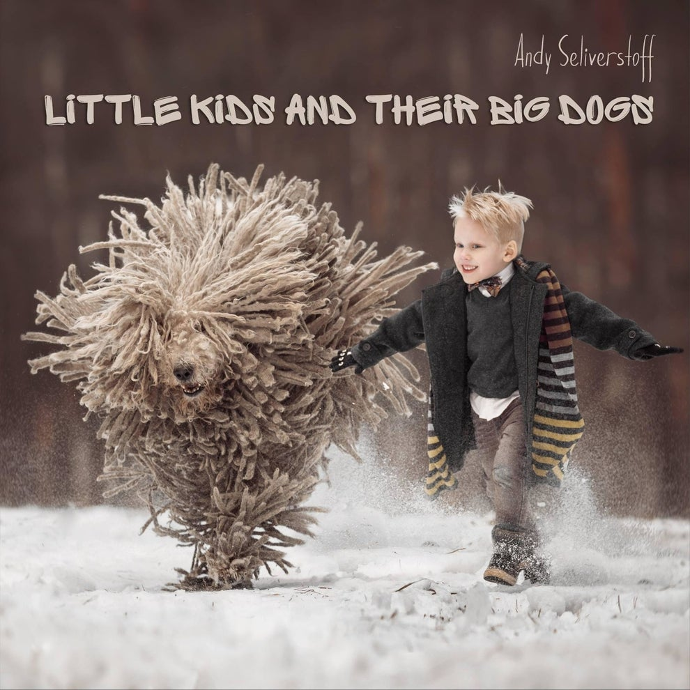 "The project has become his passion, which he chronicles in a book called ""Little Kids and Their Big Dogs."""
