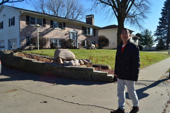 """Glad Cheng stands in front of the """"Sino-American Friendship House."""""""