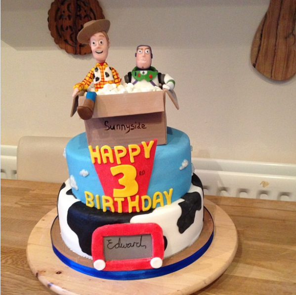 Extra points for creativity: The birthday boy is turning three; Woody and Buzz moved to Sunnyside Day Care in part... three. Baked by Peter Norgate in Manchester, England.
