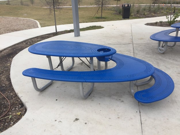 This picnic bench that has seating for small children, for adults, and a high chair.