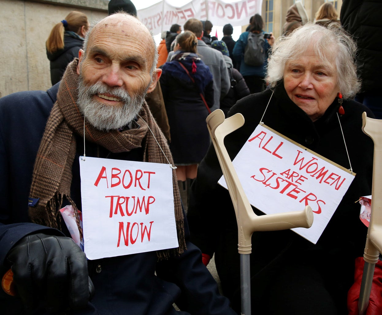 An older man takes part in the Women's March in Paris.