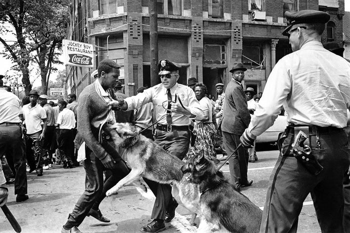 A 17-year-old civil rights demonstrator, defying an anti-parade ordinance of Birmingham, Alabama, is attacked by a police dog on May 3, 1963. On the afternoon of May 4, 1963, during a meeting at the White House with members of a political group, President Kennedy discussed this photo, which had appeared on the front page of that day's New York Times.