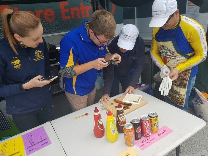 A sausage sizzle is what Australians call, well, a sausage that has been cooked on the BBQ, then wrapped in cheap white bread and topped with appropriate condiments. It's generally understood that the cheaper the sausage the better the sizzle. Australian hardware store Bunnings is renowned for hosting sausage sizzles with different community groups every weekend.