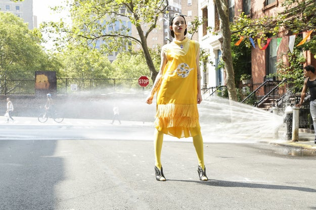 The models shot at the Children's Aid Society in Harlem. The theme of the video shoot was ~movement~, and their task was to effortlessly walk through a lively block party with a ton of distractions that could easily make them lose focus.