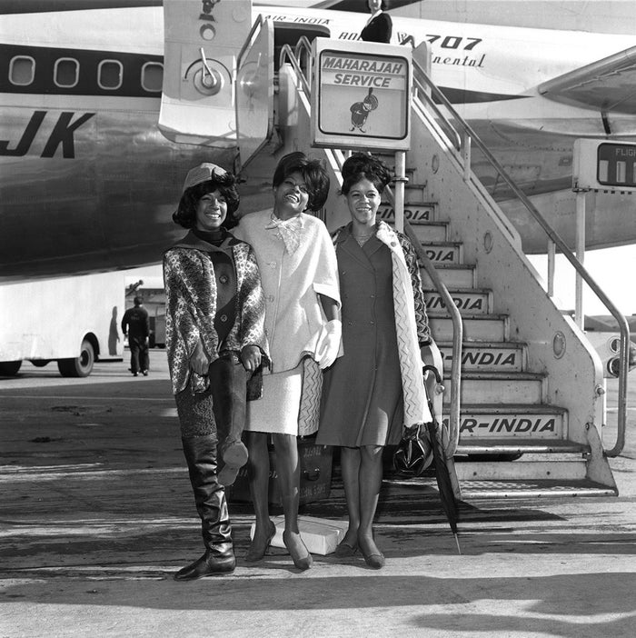 The Supremes, including Diana Ross, pose at an undisclosed airport in 1965.