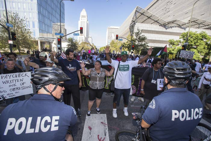 People protest the fatal police shooting of Ezell Ford on August 17, 2014.