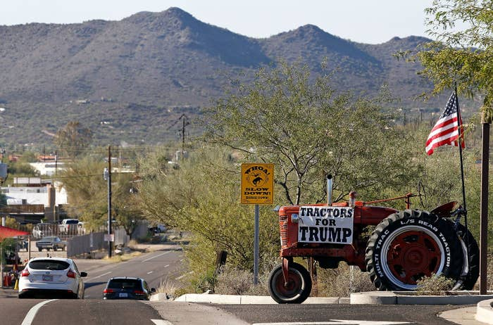 A Trump sign hangs on a farming tractor near an Arizona polling station in November.