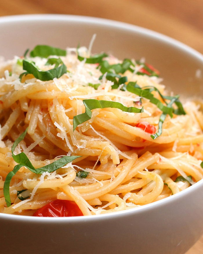 Servings: 4INGREDIENTS1 pound spaghetti2 tablespoons olive oil3 cloves garlic, minced2 cups chopped cherry tomatoesSalt, to taste Pepper, to taste1 cup white wine1 cup parmesan½ cup basil, choppedPREPARATION# Cook spaghetti in boiling salted water until it's al dente. Reserve 1 cup of the pasta water before draining.# While the spaghetti is cooking, heat olive oil in a large pan (it should be large enough to toss the pasta in). Add garlic and tomatoes, and stir until well-incorporated. Season with salt and pepper.# Cook tomatoes down for 5 minutes until they soften and release some of their juices. Then add the wine and allow that to reduce for 5-10 minutes until you're left with a syrupy sauce. # Add the pasta to your sauce, along with a splash of pasta water and toss to coat it for about 1-2 minutes so the pasta finishes cooking and absorbs the flavor of the sauce.# Add the parmesan and basil. Add another small splash of pasta water, if needed. Toss until the cheese is melted down and you're left with a smooth sauce. Gradually add small amounts of pasta water, as needed, until the sauce reaches your desired smoothness.# Top off with extra parmesan and basil and serve immediately.# Enjoy!