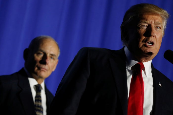 President Donald Trump flanked by Homeland Security Secretary John Kelly at Homeland Security headquarters.