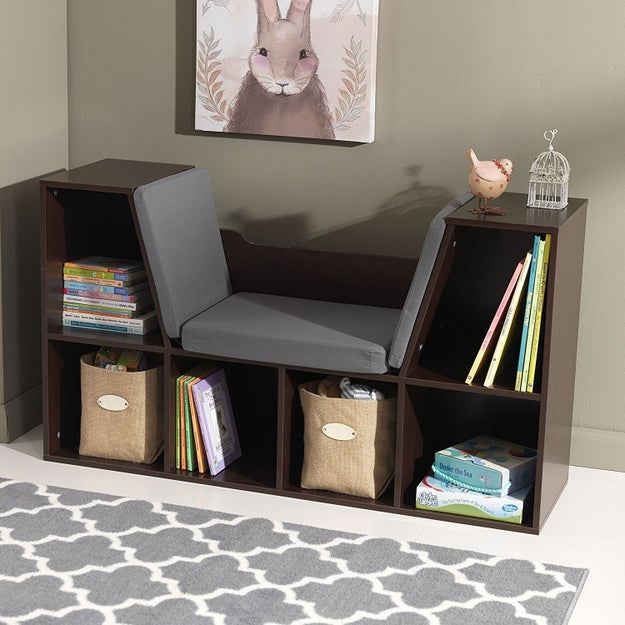 Save space with a bookcase with a cushioned reading space built right in.