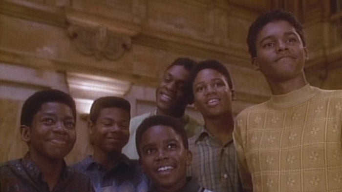 It doesn't skimp on the production, it takes the time to tell New Edition's full story in three two-hour episodes, and it also got permission from all six members of New Edition to tell their story and use their music. Each group member is a producer on the miniseries and they were all there behind-the-scenes to coach the actors that play them.