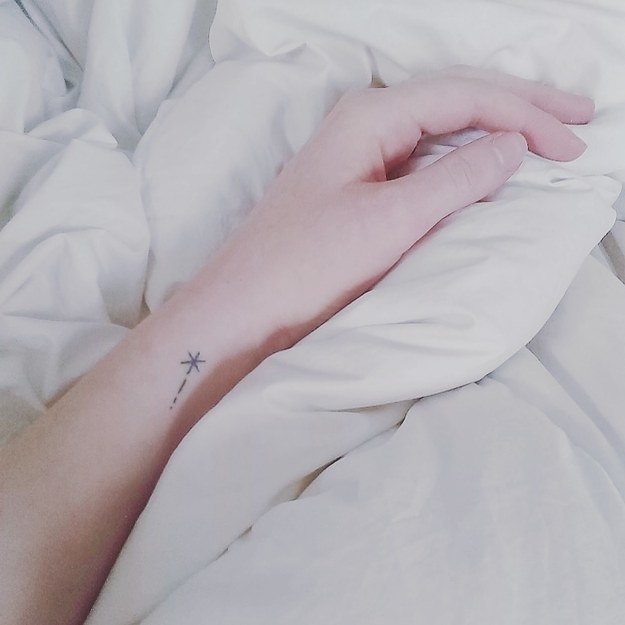 A tiny wrist tattoo of a shooting star