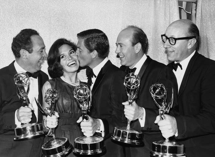 Van Dyke plants a kiss on Moore after The Dick Van Dyke Show wins an Emmy Award, May 25, 1964.