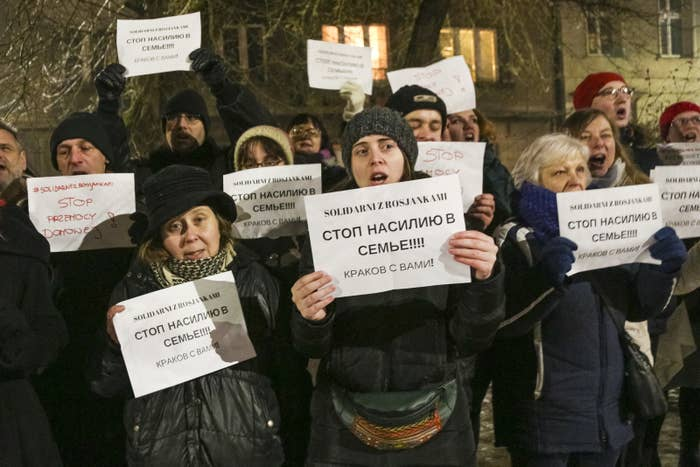 """Protesters in Poland hold banners that say """"Solidarity with the Russian Women — Stop Domestic and Physical Violence"""" in front of the Russian Consulate General in Krakow."""
