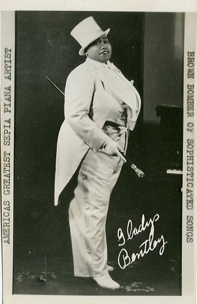 Gladys Bentley was a blues singer during the Harlem Renaissance of the 1920s and '30s. She would appear onstage as an openly lesbian drag king, and was later backed by a chorus line of drag queens. Her act involved making up her own (much raunchier) lyrics to popular songs and singing them to women in the audience in a sexy, gravelly voice. *Fans self*