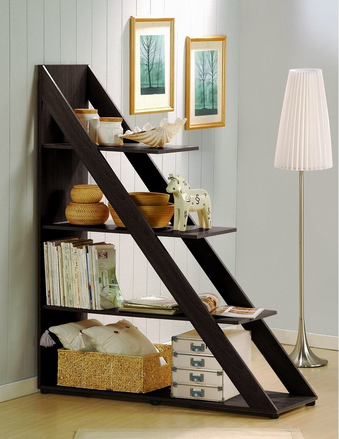 Create a small nook out of a larger room by blocking off a section with a shelf that doubles as a room divider.