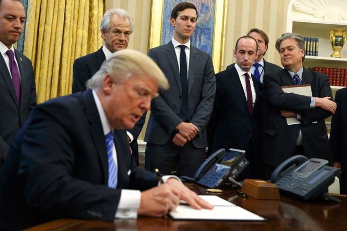 From left, White House Chief of Staff Reince Priebus, National Trade Council adviser Peter Navarro, senior adviser Jared Kushner, policy adviser Stephen Miller, and Chief Strategist Steve Bannon watch as President Donald Trump signs an executive order in the Oval Office of the White House on Jan. 23.