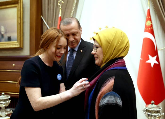 """""""We are so grateful the president decided to invite us to visit them, the work they are doing for the refugees is so inspiring,"""" Lohan's publicist Scott Carlsen said in a statement provided to BuzzFeed News via text message. He didn't elaborate on just when Erdogan first became interested in Lohan.Lohan did press the case in a statement that ran on Turkey's Andalou Agency wire service. """"This is why I underlined the statement 'the world is bigger than five,'"""" she said. """"Five big nations made promises but they did not keep them. There are some who are afraid tot come Turkey due to the disinformation about it but I feel very much at ease."""""""