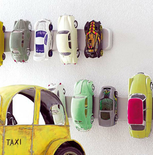 Hang your kid's toy cars on the wall using magnet knife holders.