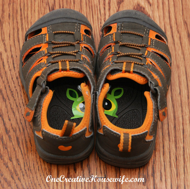 Cut a sticker down the middle, then put one half inside each of your kid's shoes. This way they'll always know which shoe goes on which foot.