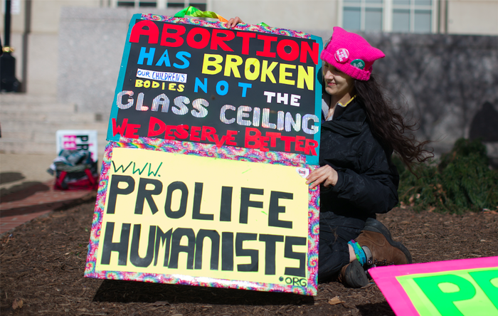 Kristine Kruszelnicki, director of Pro-Life Humanists, with her signs.
