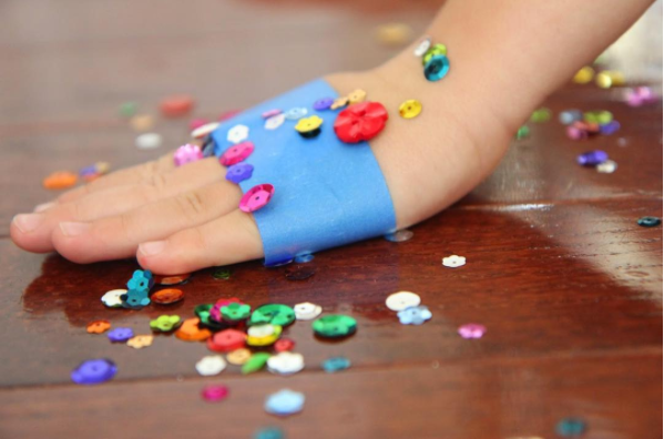 Tape is great for picking up sparkles, glitter, and other teeny-tiny things your kid spills.