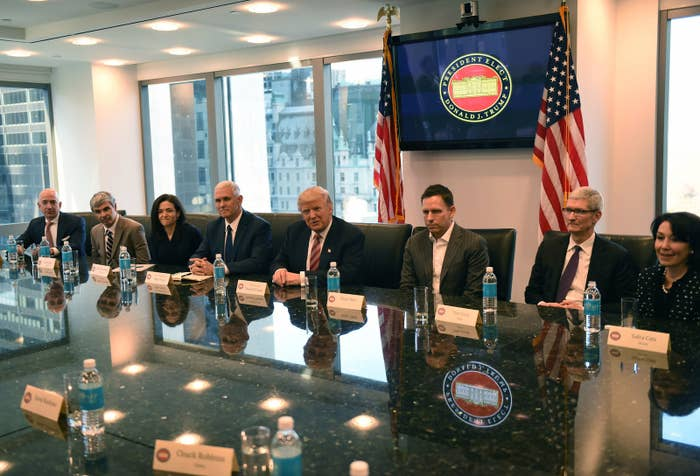 (L-R) Amazon's chief Jeff Bezos, Larry Page of Alphabet, Facebook COO Sheryl Sandberg, Vice President elect Mike Pence, President-elect Donald Trump, Peter Thiel, co-founder and former CEO of PayPal, Tim Cook of Apple and Safra Catz of Oracle attend a meeting at Trump Tower December 14, 2016 in New York.