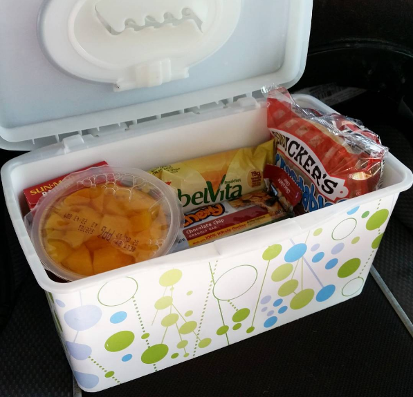 Use an empty wipes container to store travel snacks for your kid.