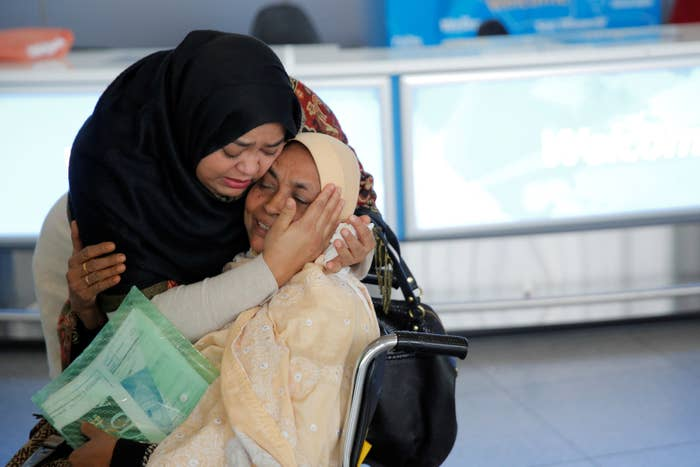 A woman greets her mother after she arrived from Dubai on Emirates Flight 203 at John F. Kennedy International Airport in Queens, New York.
