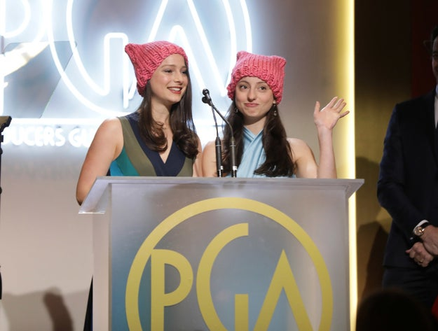 """Elizabeth and Nora Rothman opted for a non-verbal form of protest by wearing """"pussy hats"""" while presenting their father, Tom Rothman, with the Milestone Award."""