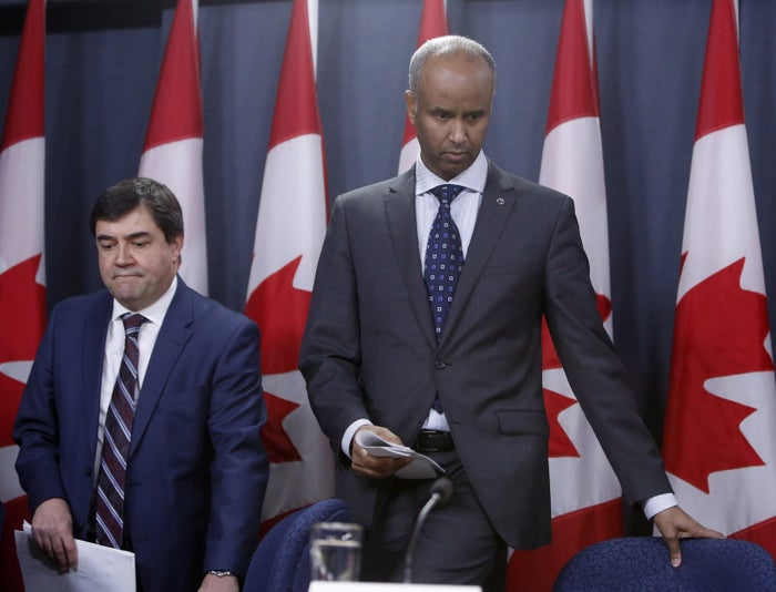 Ahmed Hussen, Minister of Immigration, Refugees and Citizenship, right, and Daniel Jean, Canadian National Security Advisor.