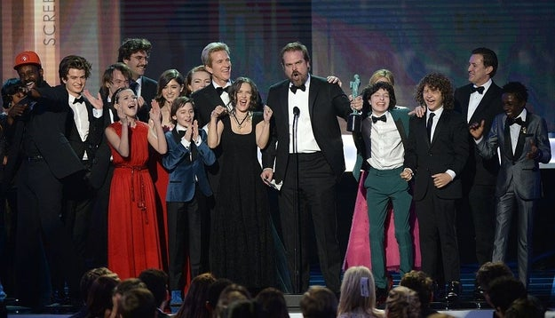 The entire cast of Stranger Things took to the stage at the SAG Awards Sunday night when they won the statue for Outstanding Performance by an Ensemble in a Drama Series. And things got pretty extra when David Harbour started speaking.